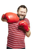 Man wearing boxing gloves smiling. On white background Royalty Free Stock Photo