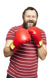Man wearing boxing gloves smiling Royalty Free Stock Photos