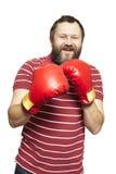 Man wearing boxing gloves smiling Royalty Free Stock Photos