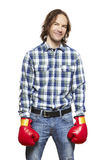 Man wearing boxing gloves smiling Stock Image
