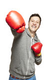 Man wearing boxing gloves smiling. On white background Stock Photo