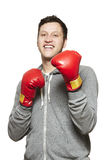 Man wearing boxing gloves smiling Stock Photos