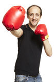 Man wearing boxing gloves smiling. On white background Stock Photos
