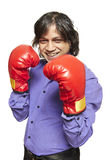 Man wearing boxing gloves smiling. On white background Stock Images