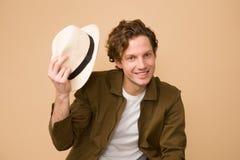 Man Wearing Brown Dress Shirt Holding White Fedora Hat Stock Photos