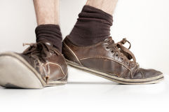 Man wearing brown shoes. Man's legs wearing brown shoes and socks Royalty Free Stock Image