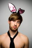 Man wearing bunny ears Stock Images