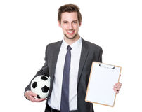 Man wearing business suit and holding soccer ball Stock Photography