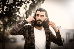 Man Wearing Camouflage Hoodie and White Shirt Royalty Free Stock Photography