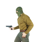 Man wearing camouflage mask with a gun Stock Photo