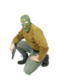 Man wearing camouflage mask with a pistol Royalty Free Stock Photography