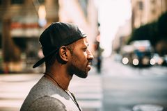 Man wearing cap back to front Stock Images