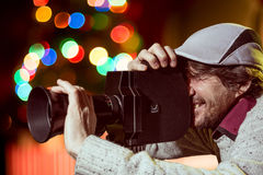A man wearing a cap with an old movie camera Royalty Free Stock Image