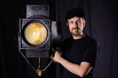 Man wearing a cap stands near stage spotlight Royalty Free Stock Photo