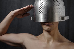 Man wearing colander as a helmet Stock Photography