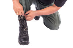 Man wearing combat shoes. On white background Royalty Free Stock Photo