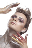 Man wearing a conceptual make up with giltter Stock Image