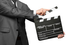 Man wearing costume holding clapper board Royalty Free Stock Photography