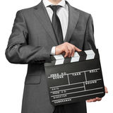 Man wearing costume holding clapper board Royalty Free Stock Photo