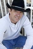 Man wearing cowboy hat Stock Images