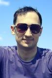 Man wearing creative fashion sunglasses Stock Image