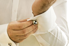 Man Wearing Cufflinks Royalty Free Stock Image