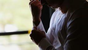 Man wearing cufflinks stock video footage