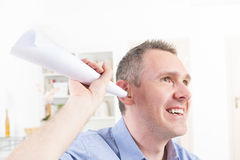 Man wearing deaf aid trying to hear something Royalty Free Stock Photography