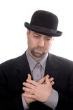Man wearing a derby. Sad Man wearing a derby hat over a white background royalty free stock photography