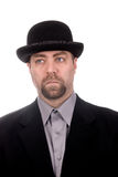 Man wearing a derby. Sad Man wearing a derby hat over a white background stock photos