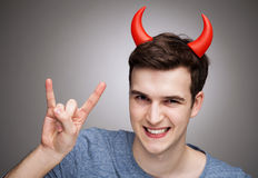 Man wearing devil horns Stock Photos