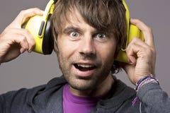 Man wearing earmuff. Smiling man wearing yellow earmuff Stock Photography