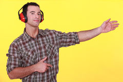 Man wearing earmuffs Stock Image