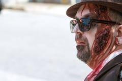 Man Wearing Elaborate Zombie Makeup Awaits Atlanta Pub Crawl Event. Atlanta, GA, USA - July 25, 2015: A man wearing elaborate zombie makeup awaits the start of royalty free stock image