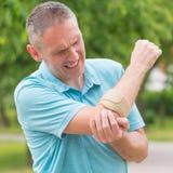 Man wearing elbow brace Royalty Free Stock Image