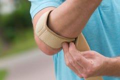 Man wearing elbow brace Stock Photos