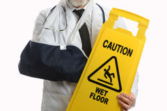 Man Wearing Elbow Sling with Caution Sign Stock Image