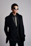 Man wearing elegant black suit and sunglasses Stock Image