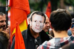 Man wearing Emmanuel macron mask at protest Royalty Free Stock Photos