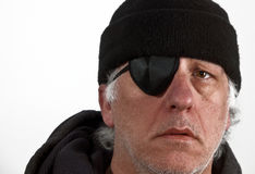 Man wearing eye patch and wool hat Royalty Free Stock Photo
