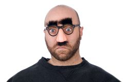 Man wearing fake nose and glas. Ses with mustashe and eyebrows over a white background royalty free stock image