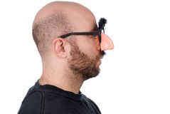 Man wearing fake nose and glas Stock Image