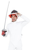 Man wearing fencing suit practicing with sword Royalty Free Stock Photography