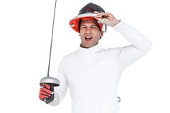 Man wearing fencing suit practicing with sword Stock Images