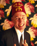 Man wearing fez hat Stock Photography