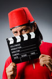 Man wearing fez hat Stock Images