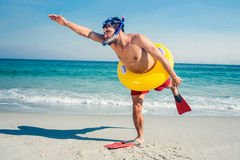 Man wearing flippers and rubber ring at the beach Royalty Free Stock Photos