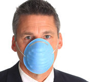 Man wearing a flu mask Stock Photo
