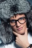 Man wearing fluffy hat Stock Images