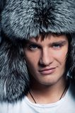 Man wearing fluffy hat Royalty Free Stock Photo